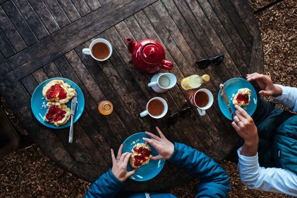 two people having a cream tea in Devon